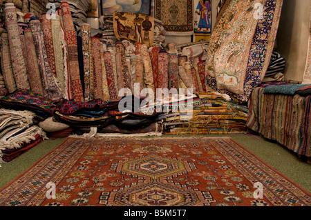 A carpet shop in the market Luxor Egypt - Stock Photo