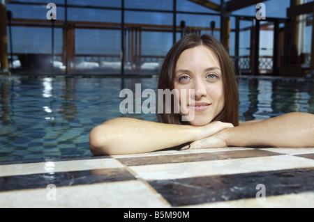 A woman in the pool. - Stock Photo
