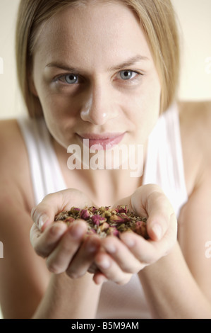 Woman with her hands full of potpourri. - Stock Photo