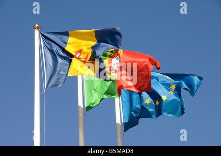 Flags flying of Madeira Portugal and the European Union - Stock Photo