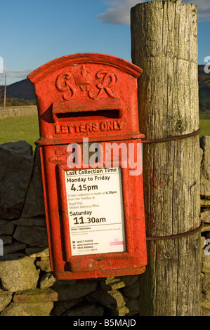 Old letterbox on wooden post Upper Wharfedale North Yorkshire England UK United Kingdom GB Great Britain - Stock Photo