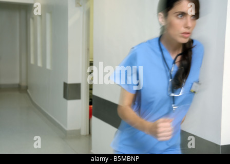 Female doctor in an emergency rush - Stock Photo