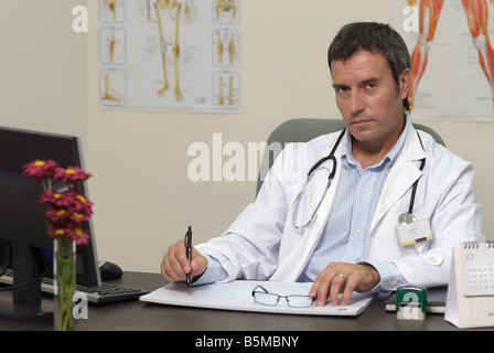 Doctor attending at office - Stock Photo