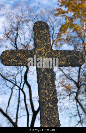 Golden forged cross on tomb in Alexander Nevsky Lavra - Stock Photo