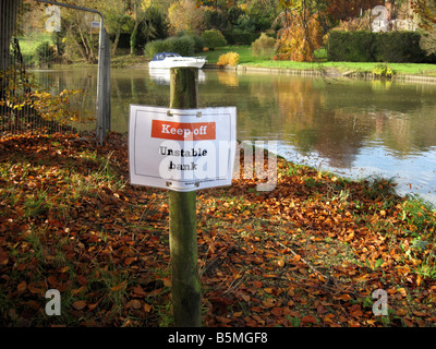 Unstable Bank Sign on River Thames - Stock Photo