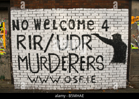 Republican/Nationalist mural on Divis Street/Falls Road. 'No welcome 4 RIR/UDR Murderers.  www.osf.ie' Stock Photo