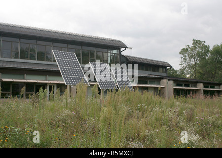 Photovoltaic panels PV in a natural prairie planting on the University of North Iowa campus - Stock Photo