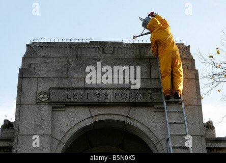 Council Worker Cleaning The Cenotaph in Bolton Lancashire UK - Stock Photo