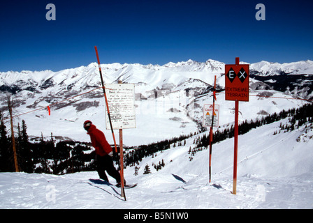 Downhill skier takes off on Extreme Limits Run Crested Butte Resort Colorado USA Downhill Skiing - Stock Photo