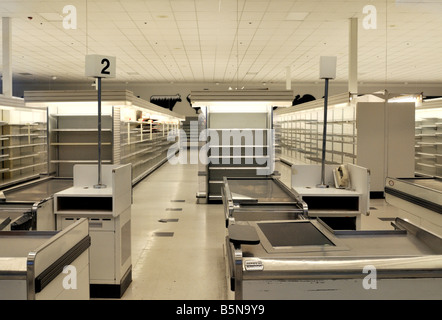 View of empty grocery store with empty shelves gone out of business during tough economic times in America - Stock Photo