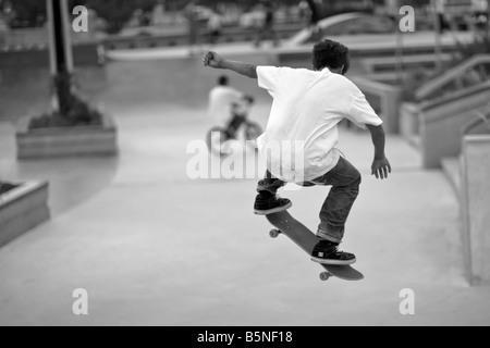Skateboarder at a skateboard park. - Stock Photo