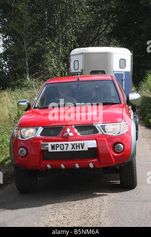 Mitsubishi L200 Raging Bull pickup towing horse trailer - Stock Photo
