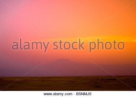 Mount Kilimanjaro at sunset seen from Amboseli National Park Kenya - Stock Photo