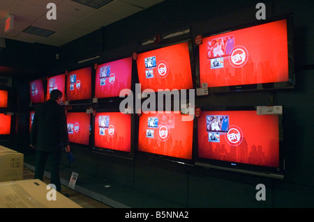 A customer browses the television display in a Circuit City electronics store in New York - Stock Photo