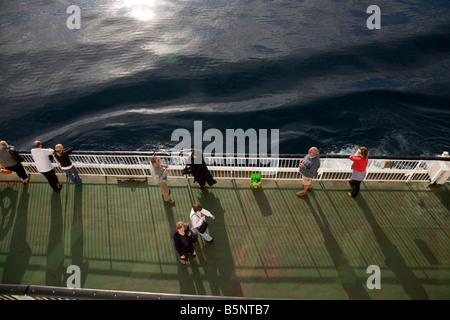 Passengers relaxing on a ferry deck - Stock Photo