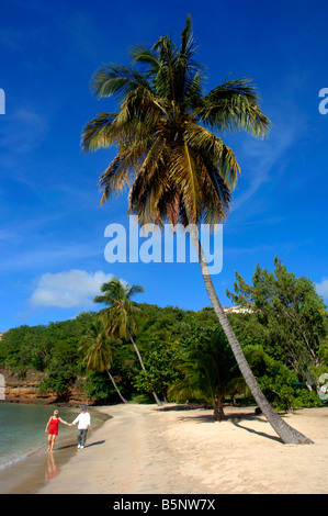 Couple walking on the beach at Lance Aux Epines Grenada in the 'West Indies' - Stock Photo