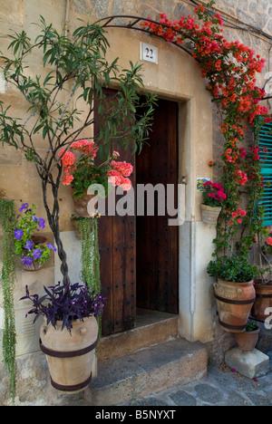 Doorway with flowers, Valldemossa, Mallorca, Spain - Stock Photo