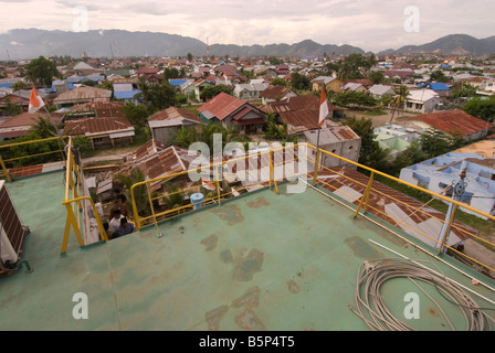 View over Banda Aceh from the top of the electric generator ship dumped inland by tsunami. - Stock Photo