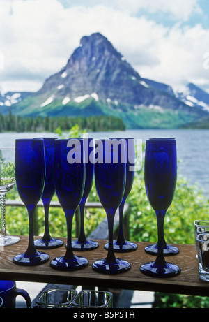 View from window of hotel onto lake in Glacier National Park, Montana, USA wine water peak snow glacier - Stock Photo