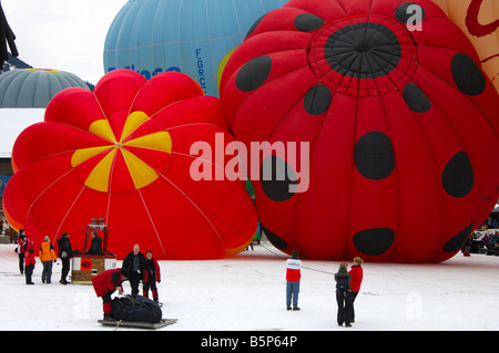 Preparation of hot air ballons for take off on the launching site, International Balloon Festival, Chateau d Oex, - Stock Photo