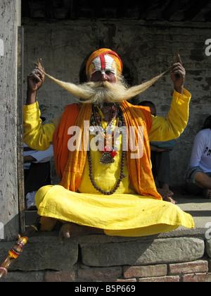A Hindu holy man (sadhu) shows off his moustache at the sacred site of Pashupatinath (aka Pashupati) east of Kathmandu, - Stock Photo