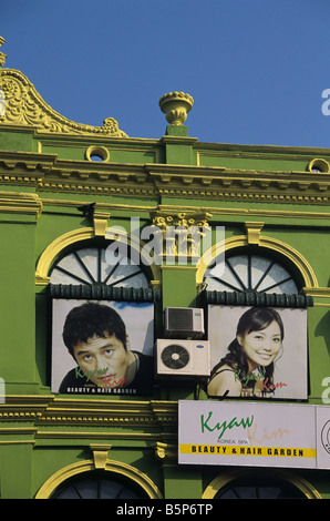 Advertising for a beauty and hair salon, on painted colonial facade, in central Rangoon or Yangon, Burma or Myanmar - Stock Photo