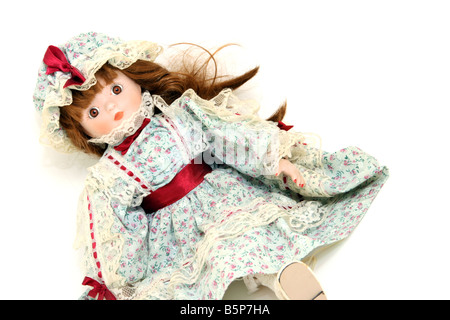 beautiful antique porcelain doll old fashioned on white background - Stock Photo
