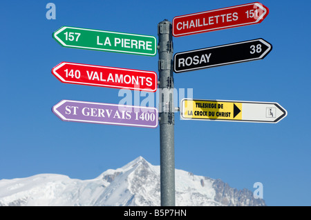 Signpost for slopes, Mont Blanc Massif behind, St Gervais Mont Blanc ski resort, Haute Savoie, France - Stock Photo