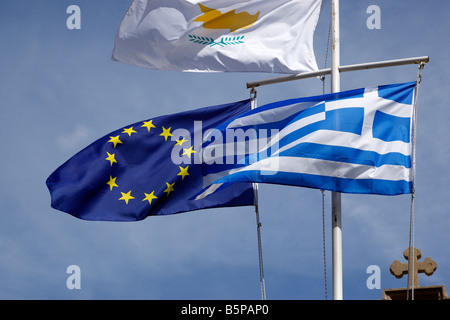 the flags of the european union cyprus and greece flying on poles kalavasos cyprus - Stock Photo
