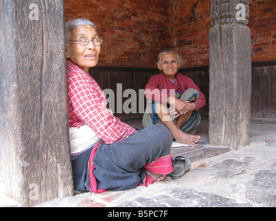 Newari women wearing traditional costume in Bhaktapur (aka Bhadgaon and Khwopa) in the Kathmandu valley, Nepal, - Stock Photo
