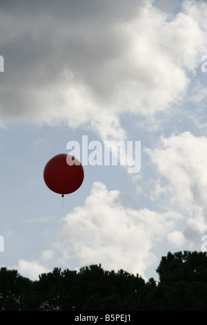one weather station balloon and clouds formation pattern in empty sky - Stock Photo