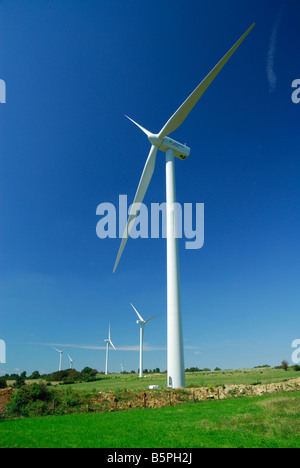 vertical and large view windturbines of wind farm on blue sky  -  France - Stock Photo