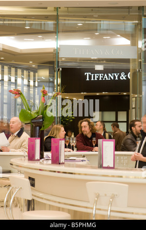 Champagne bar and Tiffany jewelery store in Westfield Shopping Centre White City Development W12 London United Kingdom - Stock Photo
