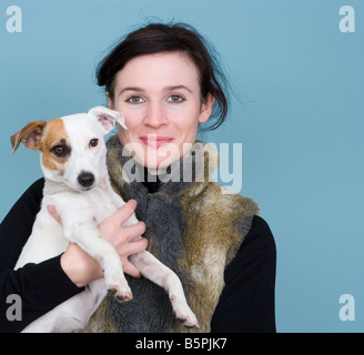 Woman holding Jack Russell dog smiling portrait close up - Stock Photo