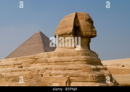 The Great Sphinx of Giza, with the Pyramid of Khafre in the background, Cairo Egypt - Stock Photo