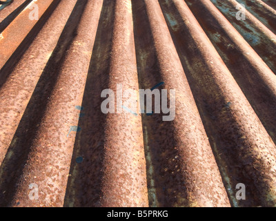 Rusty corrugated metal surface. Abstract background texture. - Stock Photo