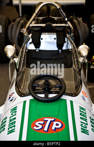 1970 McLaren-Chevrolet M10B in the paddock with steering wheel off at Goodwood Festival of Speed, Sussex, UK. - Stock Photo