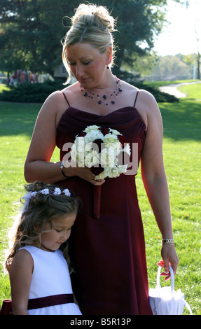 A portrait of a brides maid and a flower girl also mother and daughter - Stock Photo