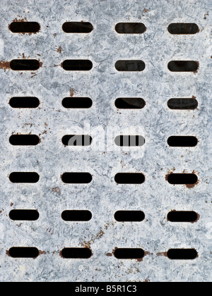 Perforated galvanized plated metal surface. Abstract background texture. - Stock Photo
