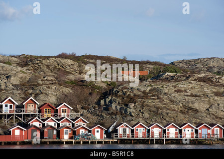 Brightly painted wooden summer bathing huts in Skarhamn Sweden's Bohuslan coast 2008 - Stock Photo