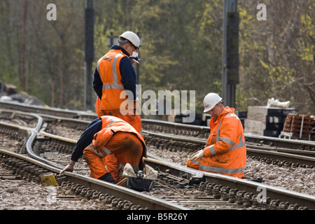 Railway workers on train line in Doncaster Uk - Stock Photo