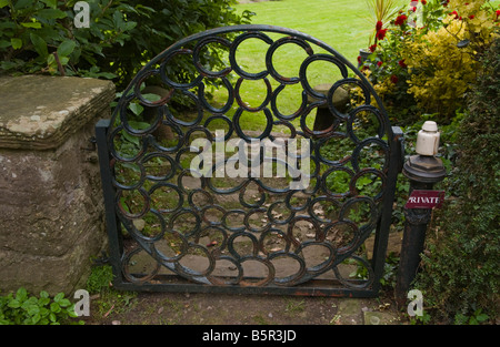 Garden gate made of horseshoes at Usk Castle in the market town of Usk Monmouthshire South Wales UK - Stock Photo