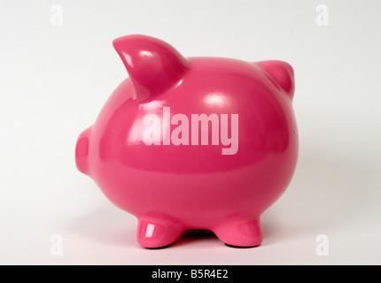 A studio shot of a pink piggy bank, money box, side view, side profile, horizontal, colour image, color image - Stock Photo