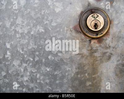 key lock on a galvanized door - Stock Photo