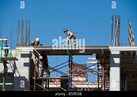 Construction workers building extension - Stock Photo