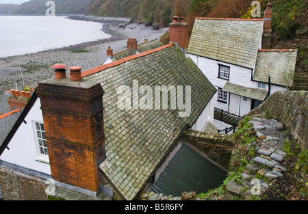View over rooftops of cottages in the coastal village of Clovelly North Devon England UK - Stock Photo
