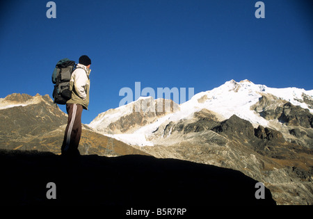 Trekker looking at view to Mount Huayna Potosi, Cordillera Real, Bolivia - Stock Photo