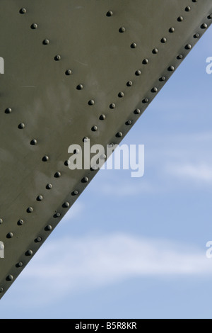 close up detail of green metal panels on aircraft - Stock Photo