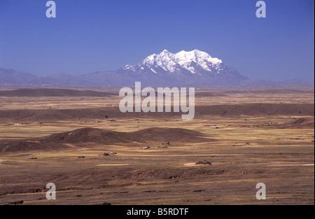Mt Illimani seen from across altiplano near La Paz, Cordillera Real, Bolivia - Stock Photo