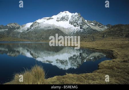 Mt Huayna Potosi reflected in lake, Cordillera Real, Bolivia - Stock Photo